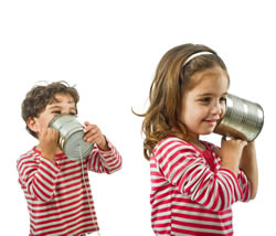 Two kids with a tin can telephone
